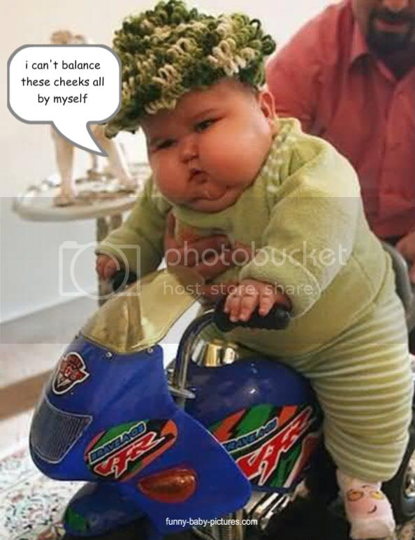 funny picture of baby with chubby cheeks balancing on a motorcycle